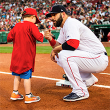 2020 Jimmy Fund Captain Mitch Moreland with a pediatric patient at Fenway Park