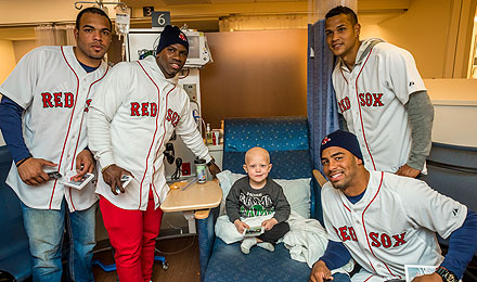 The temperatures outside were dipping near zero, but all was warm inside the Jimmy Fund Clinic when young Red Sox players visited patients and families.