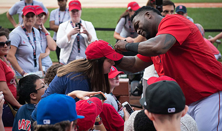 David Ortiz signs autographs for young patients