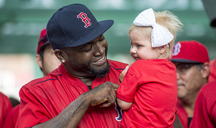 David Ortiz holds a pediatric patient at the 2016 WEEI / NESN Jimmy Fund Radio-Telethon