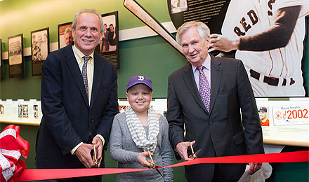 Larry Lucchino, pediatric patient Gianna Martiniellonew, and Dana-Farber President and CEO Edward J. Benz Jr., MD