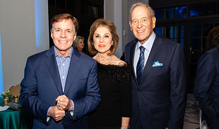 Bob Costas (left) with Phyllis and Paul Fireman
