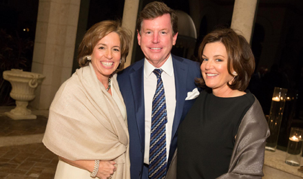 Institute Trustee Nancy Gibson (left) with Tom and Mary Quick