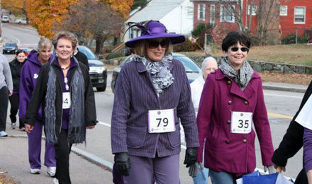 Walkers at the Promises for Purple pancreatic cancer fundraising walk sported their best purple outfits.