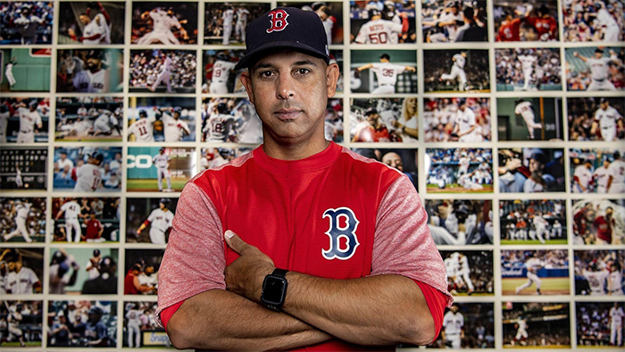 Alex Cora in front of his Boston Red Sox Wall of Wins